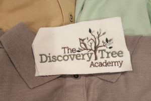 Embroidery sew out of The Discovery Tree Academy logo